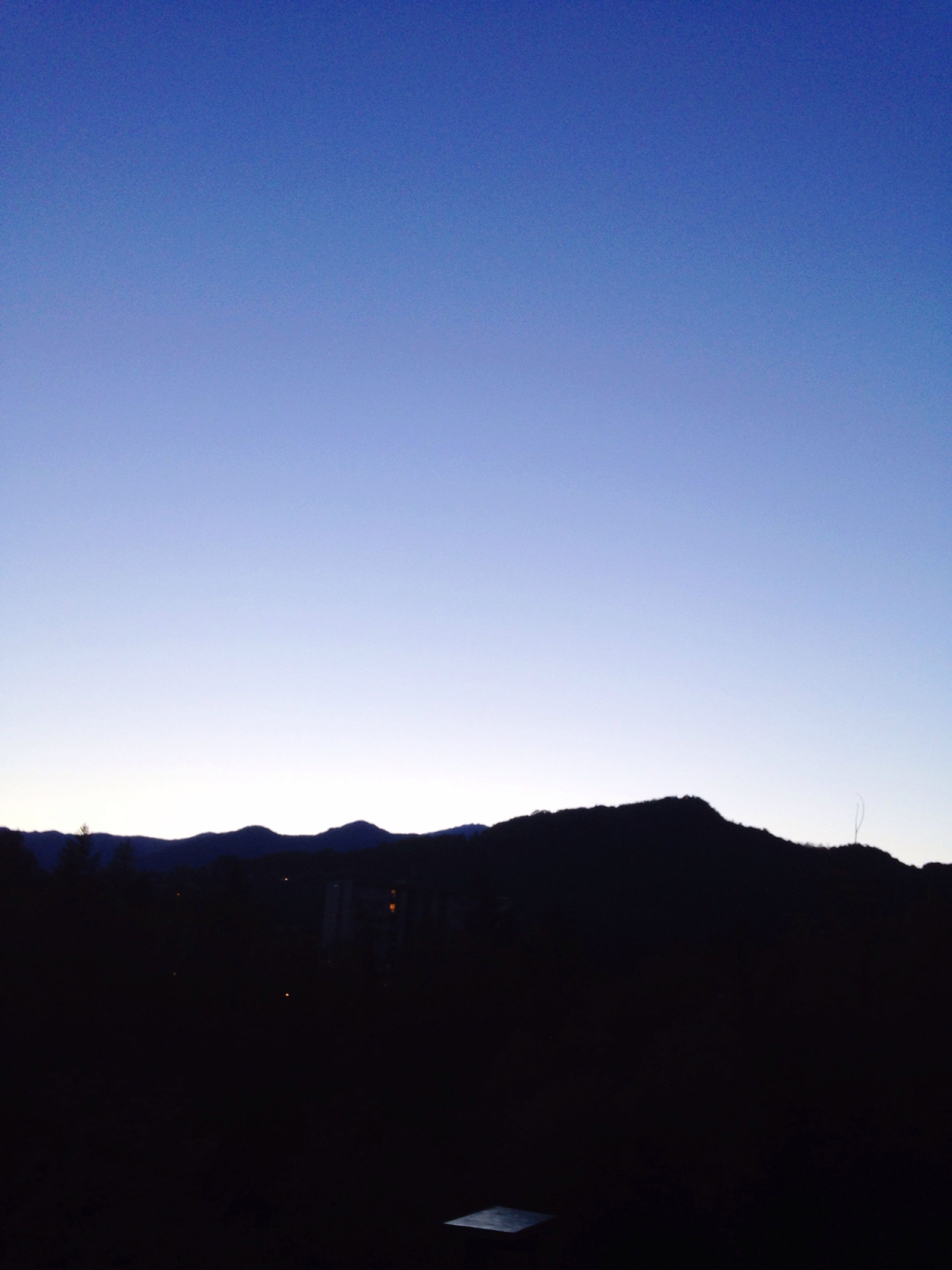 copy space, clear sky, mountain, blue, silhouette, tranquil scene, scenics, tranquility, beauty in nature, mountain range, nature, landscape, dusk, dark, outdoors, idyllic, no people, moon, night, non-urban scene