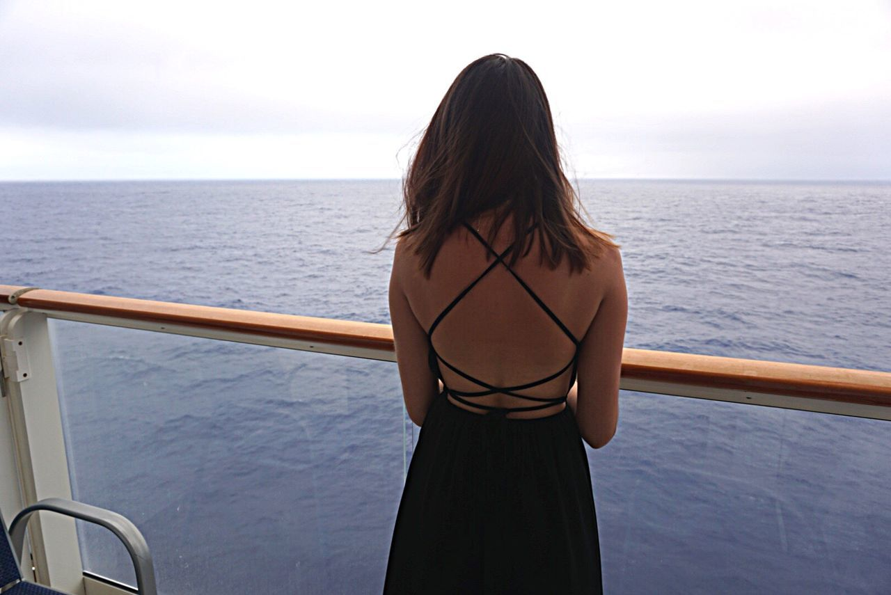 Sea Water Railing Rear View Horizon Over Water Person Long Hair Tourist Sky Three Quarter Length Nautical Vessel Standing Scenics Remote Relaxation Tranquil Scene Beauty In Nature Tranquility Tourism Casual Clothing People And Places