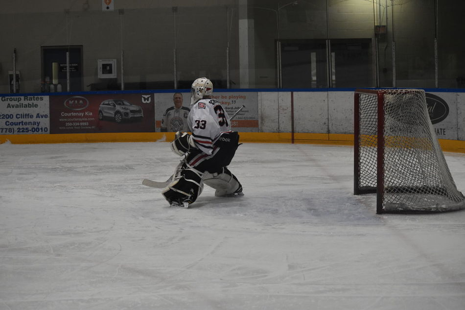 Hockey Ice Hockey In Action Goal Keeper Goalie Goalie Mask Hockey Player Hockey Helmet One Person Defense Goal Challenging Competitive Sport Hockey Players Hockey Teams Sports Photography Sports Alertness Defensive Fighting Position Defensive Hockey Game Hockey Match Hockey Arena Ice Rink Ice Skating