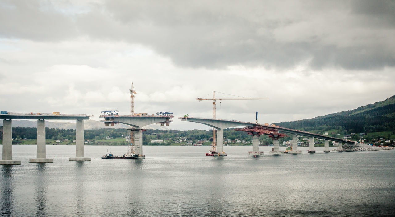 Boat Bridge Construction Construction Site Crane Day Fjord Free Cantilever Method Grey Mobile Scaffold Mountain Møre Og Romsdal Nature No People Norway Outdoors Sky Tranquil Scene Tranquility Transportation Tresfjordbrua Water Works