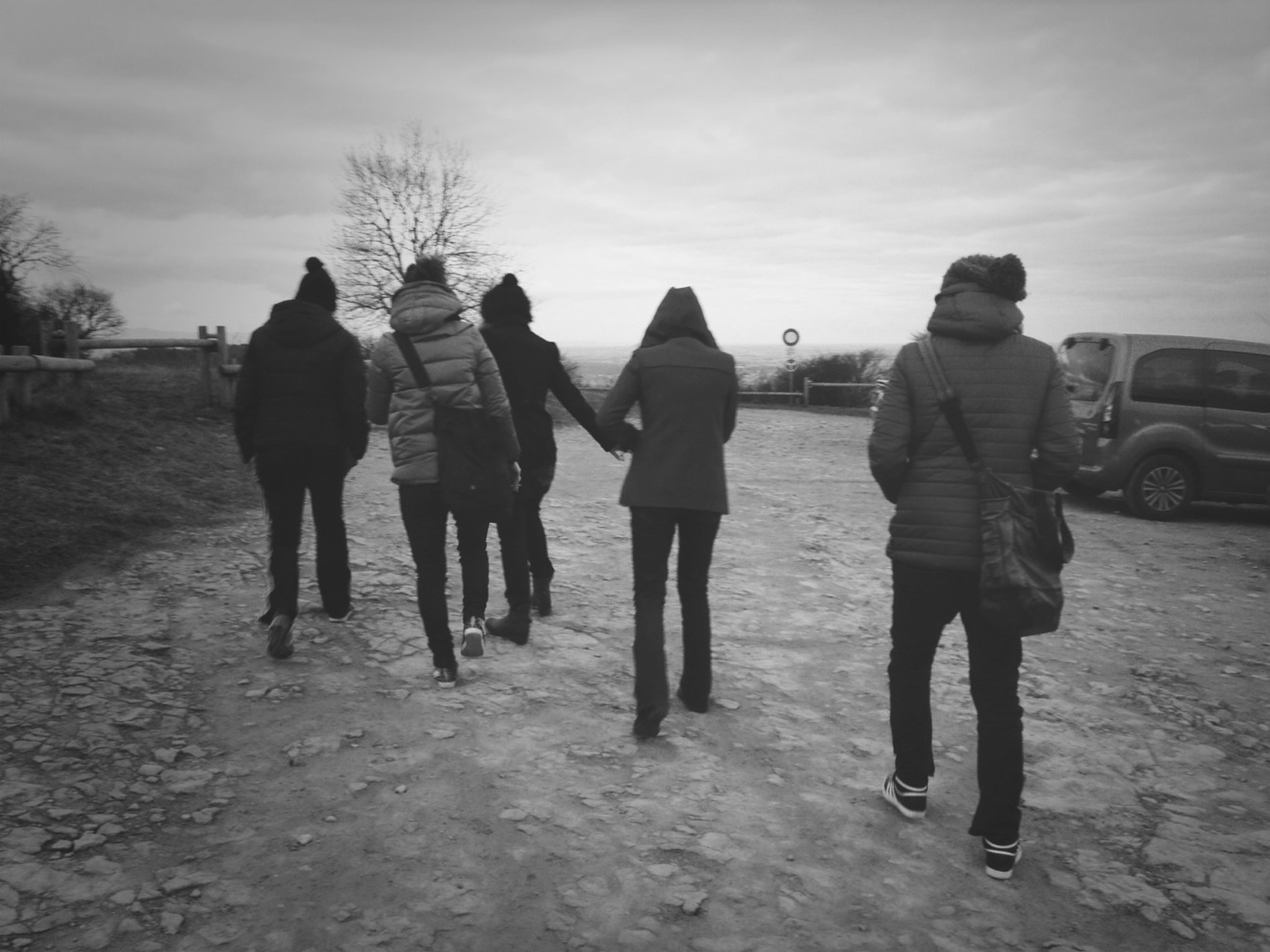 lifestyles, togetherness, men, full length, leisure activity, rear view, casual clothing, bonding, sky, walking, love, friendship, person, holding hands, boys, standing, street