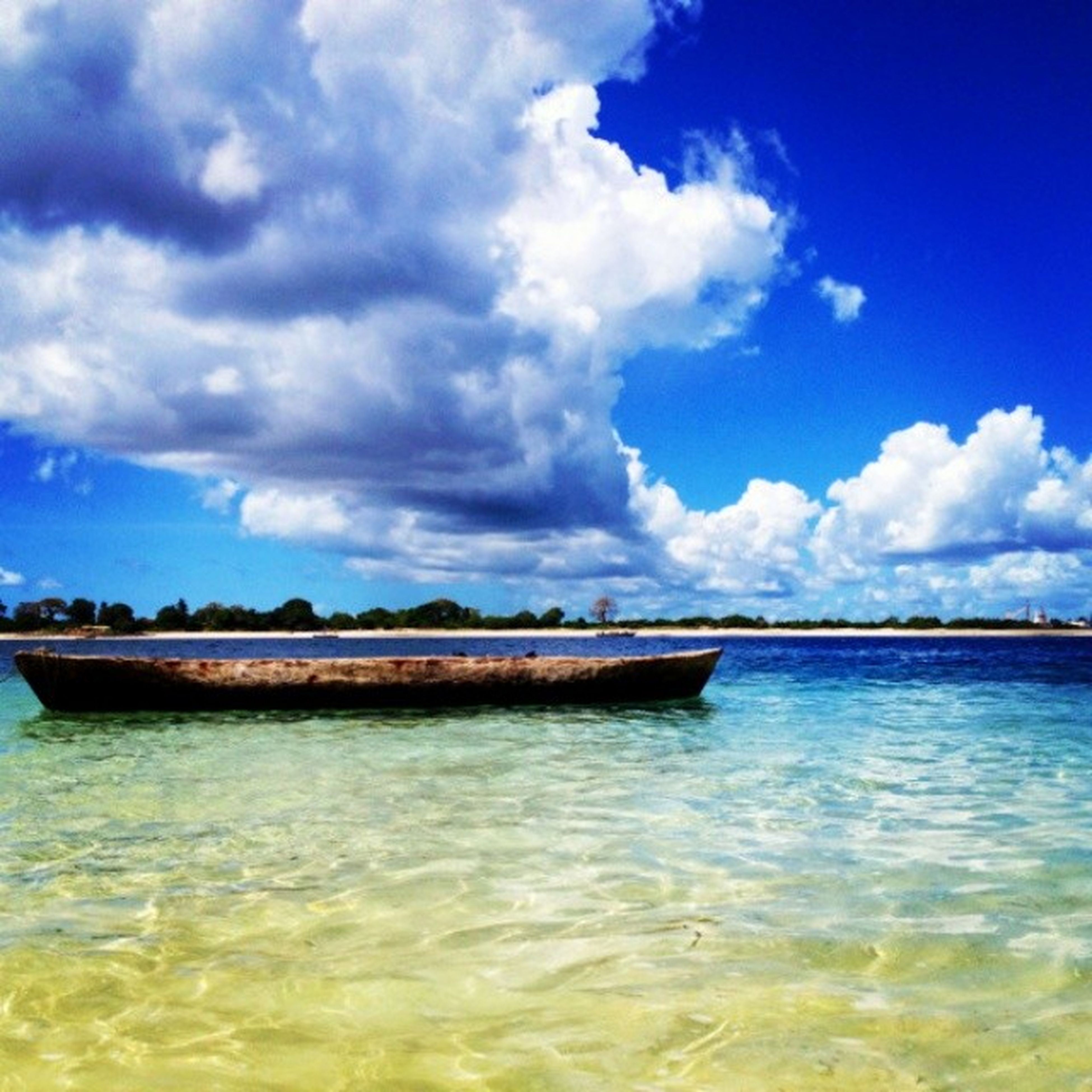 water, sky, waterfront, blue, cloud - sky, tranquil scene, sea, cloud, tranquility, nautical vessel, scenics, transportation, rippled, beauty in nature, boat, nature, mode of transport, cloudy, reflection, lake