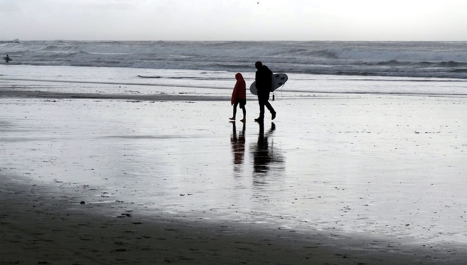 Father & Son On The Beach Young Surfer Coastline Fun On The Beach Cloud - Sky Incidental People Horizon Over Water Clouds And Waves Atlantic Ocean Silhouette Winter Surfing Beauty In Nature Nature And People Family By The Sea