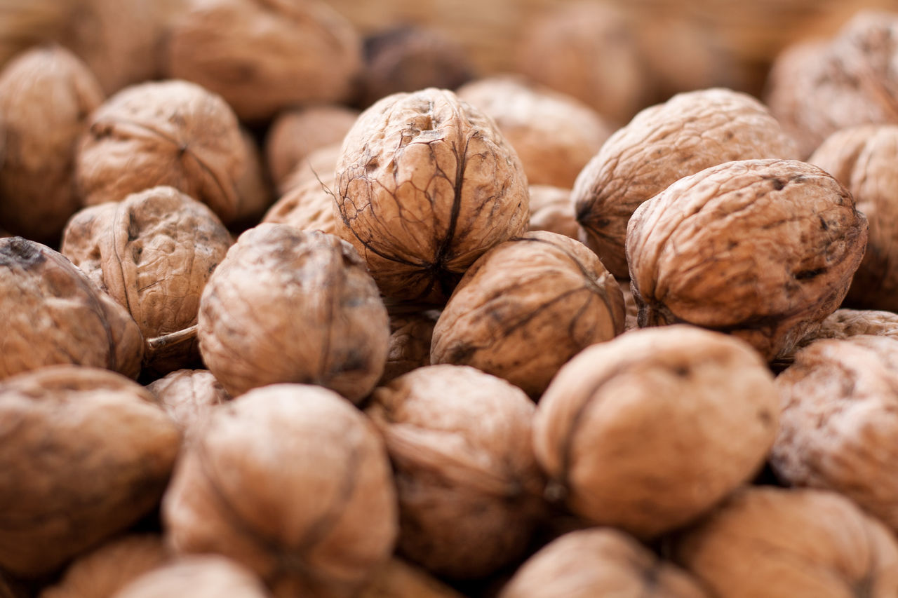 A heap of walnuts for sale at Davis farmers' market Brown Farmers' Market Food Food And Drink Heap Market Market Stall Pile Walnut Walnuts