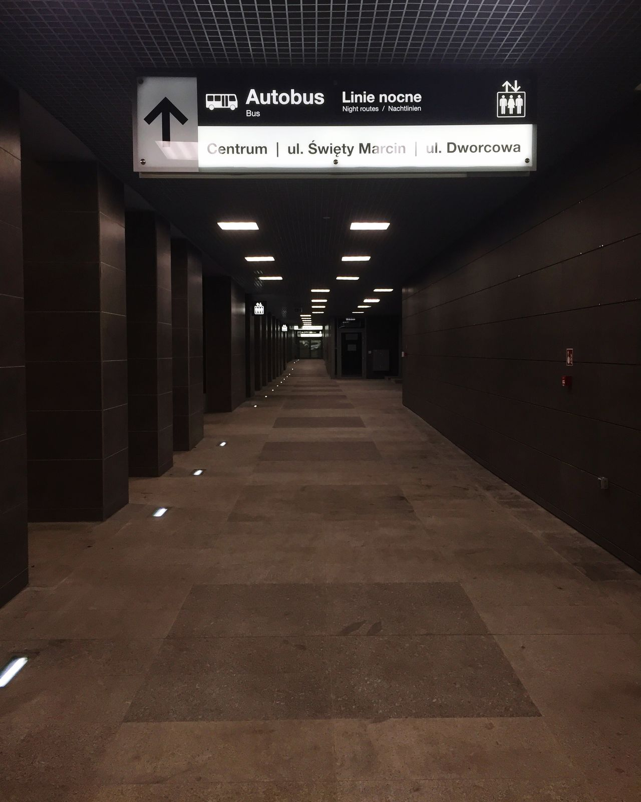 Illuminated Communication Subway Station Indoors  Tiled Floor Text Information Sign The Way Forward Built Structure Architecture No People Exit Sign