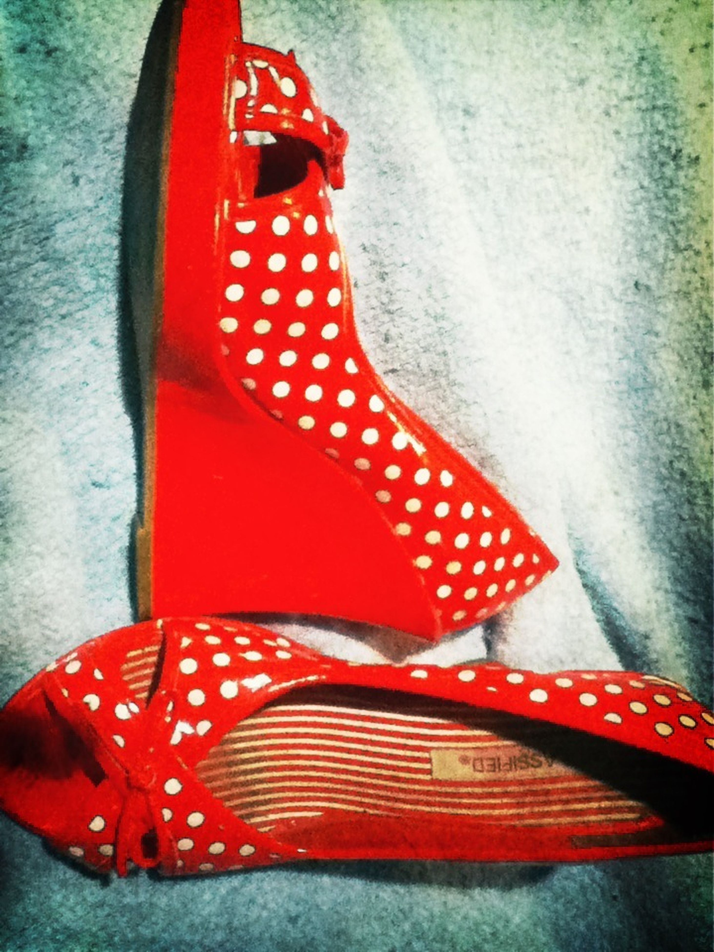 red, high angle view, close-up, striped, sunlight, indoors, day, no people, part of, shadow, pattern, star shape, single object, auto post production filter, steps, shoe, transportation, wall - building feature, wood - material