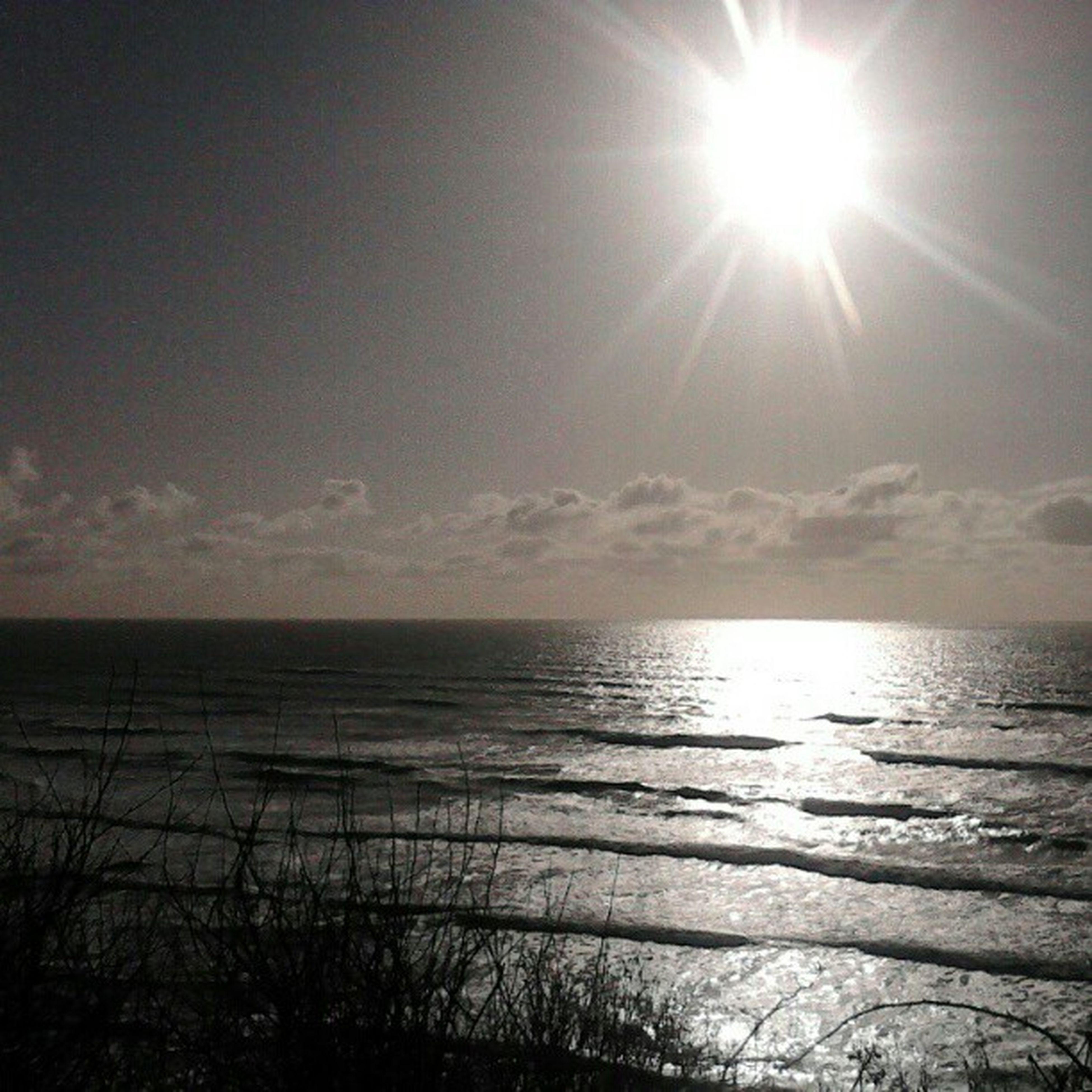 sea, sun, horizon over water, water, tranquil scene, scenics, tranquility, beauty in nature, sunbeam, sky, sunlight, reflection, nature, beach, idyllic, lens flare, sunset, seascape, shore, bright