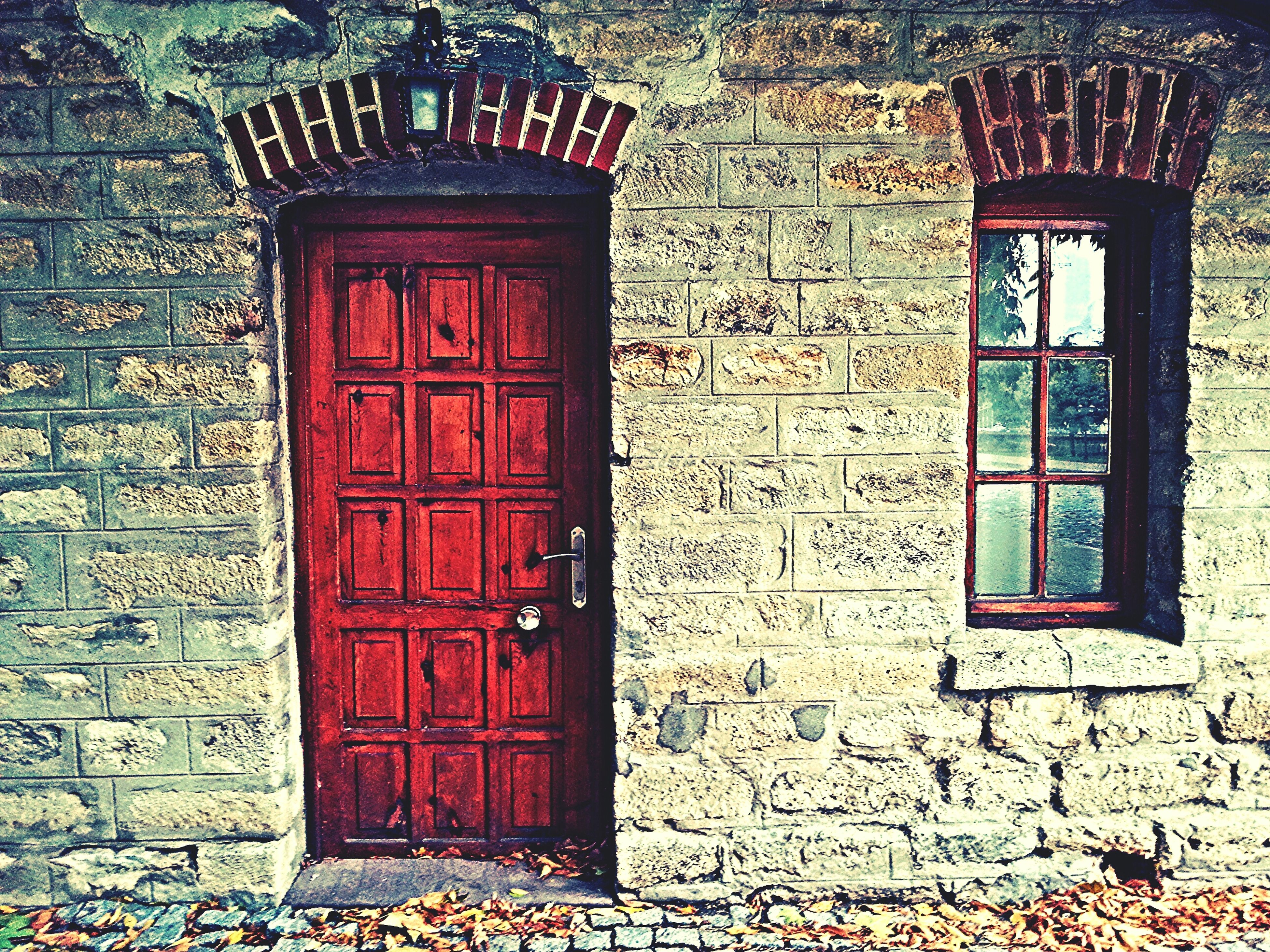 architecture, building exterior, built structure, door, closed, red, window, entrance, house, old, brick wall, wall - building feature, safety, wood - material, weathered, day, protection, wall, facade, outdoors
