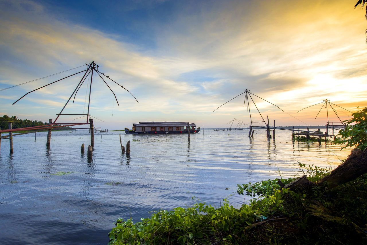 Peace by the lake Beauty In Nature Fishing Net House Boat Kerala India Lake Nature No People Outdoors Peace And Quiet Sky Sunset Tourism Tranquility Transportation Water First Eyeem Photo