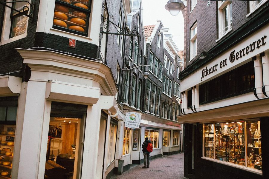 Amsterdam Ann Ilagan Photography Architecture Balcony Building Built Structure City City Life Day Diminishing Perspective Dutch Cities Europe Façade Historical Building Historical Sights Lifestyles Narrow Street One Person Outdoors Red Light District Residential Building Residential Structure Sky Store