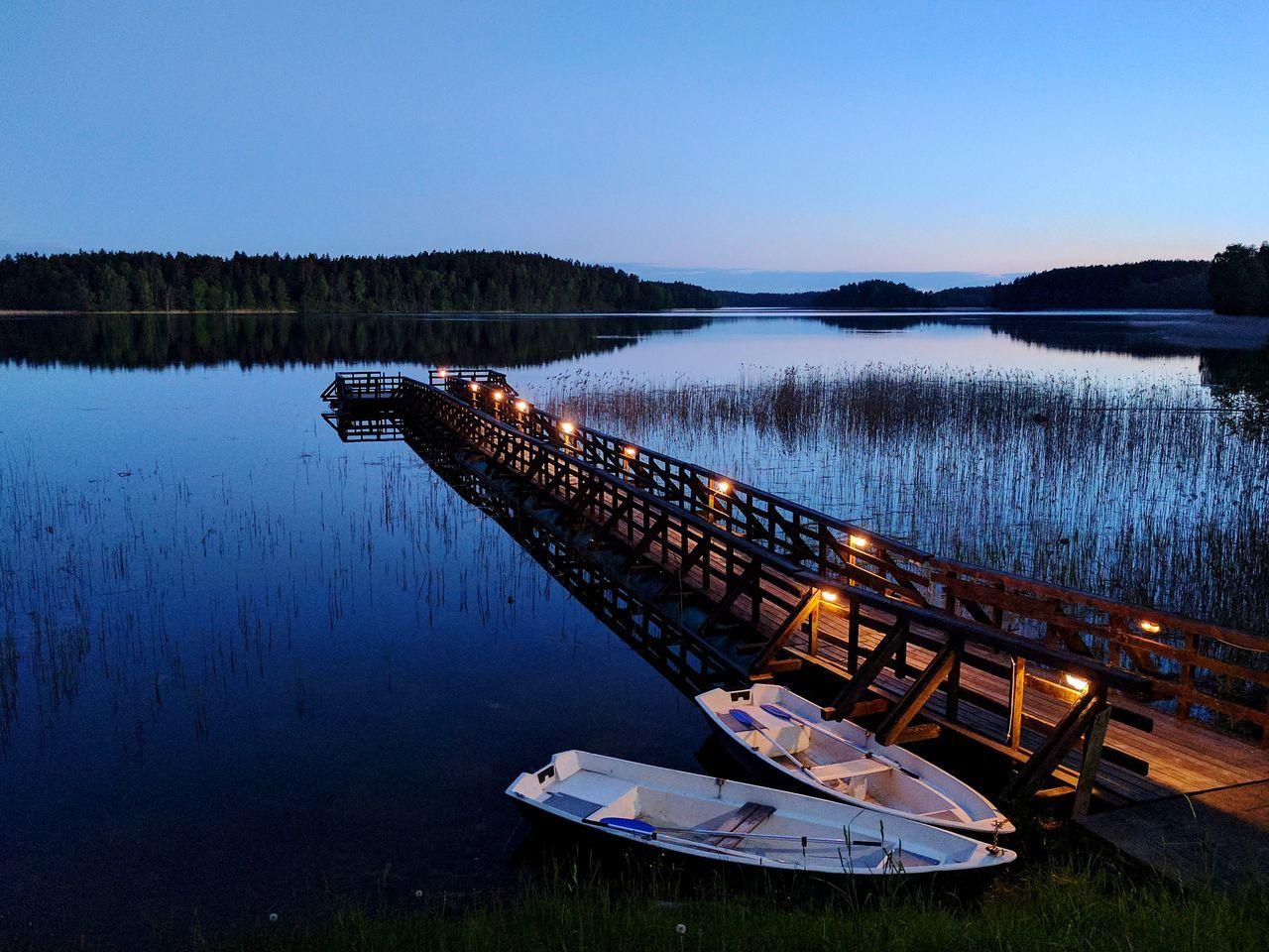 Evening on the lake Water No People Tranquility Outdoors Nature Sky Beauty In Nature After Sunset Lake Lake View Boats Lake Bridge Horizon Over Water Clear Sky Quiet Moment No Wind