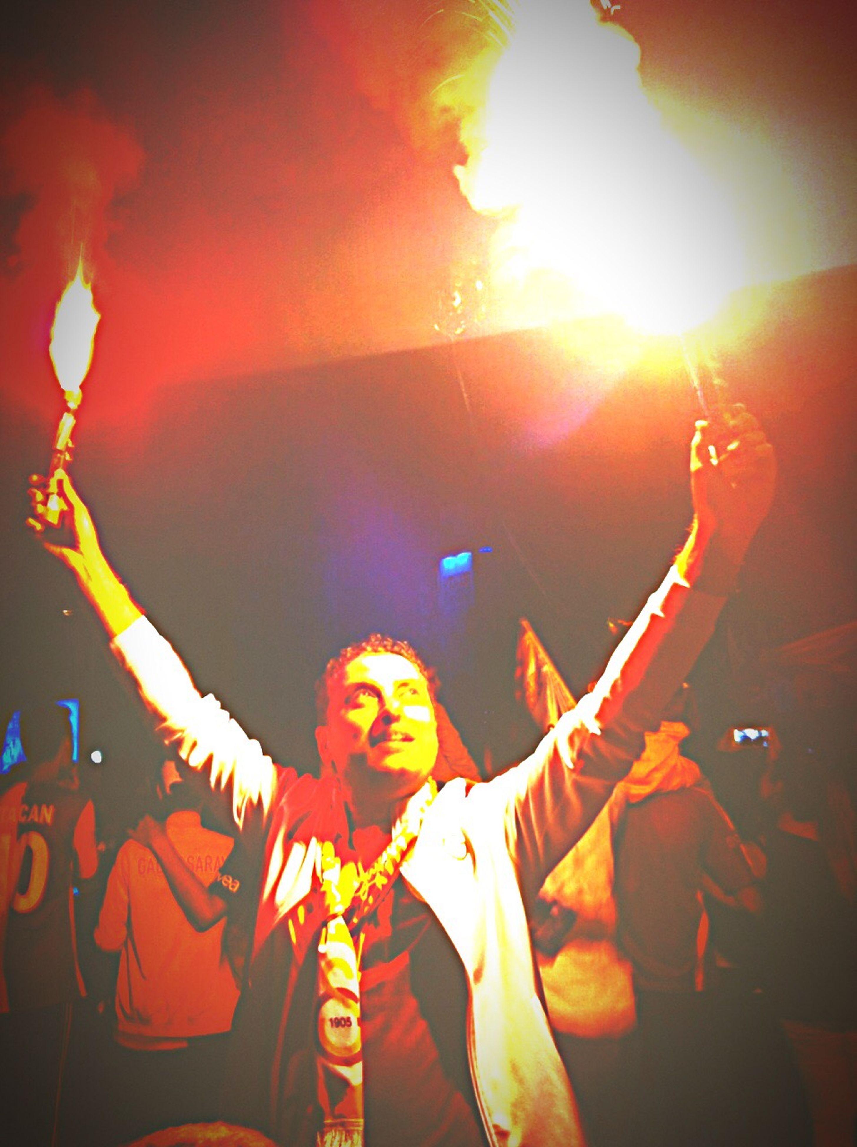 lens flare, sun, sunbeam, illuminated, burning, leisure activity, arts culture and entertainment, orange color, celebration, sky, enjoyment, glowing, flame, sunset, lifestyles, men, sunlight, low angle view, fun
