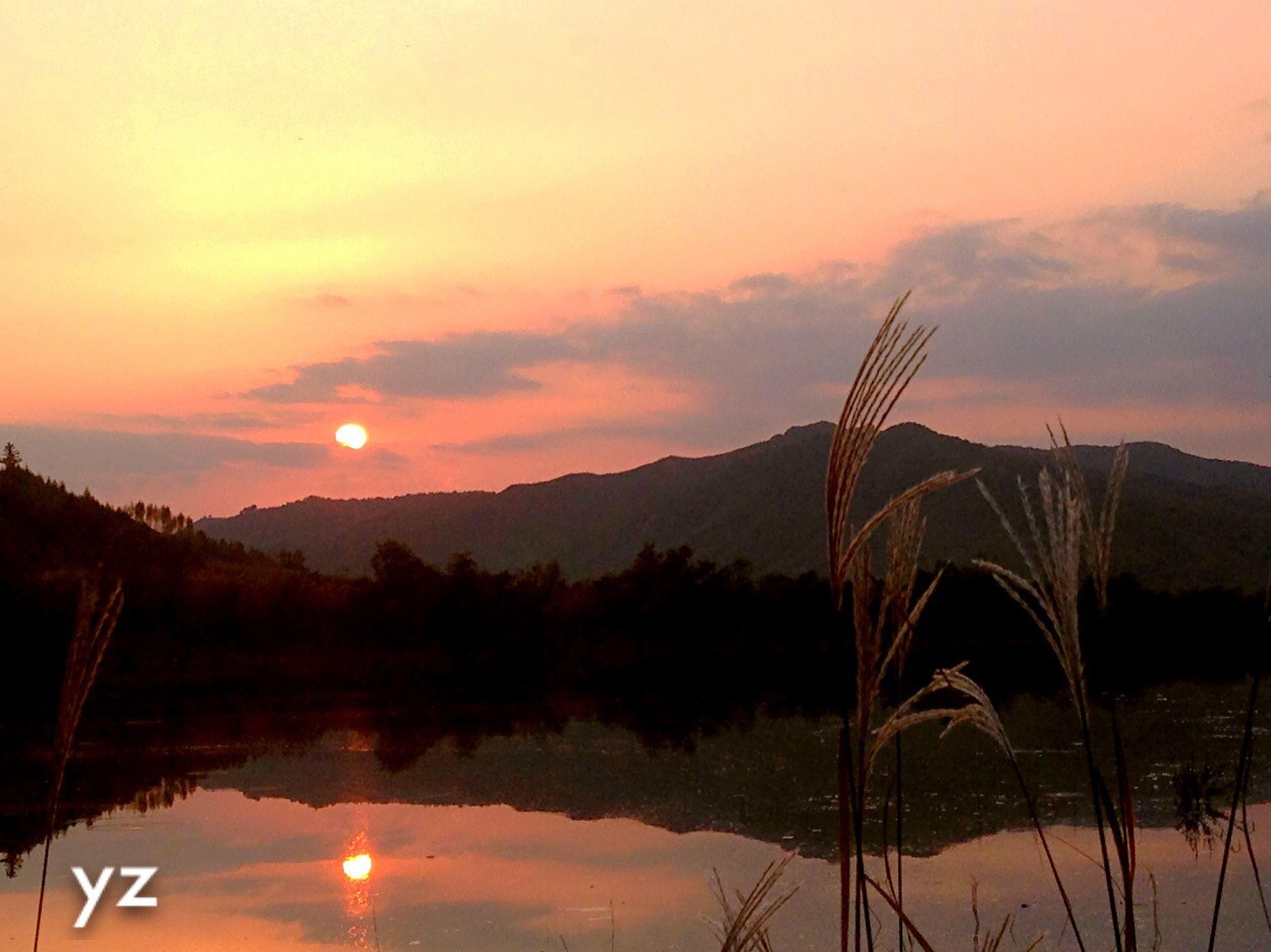 sunset, water, reflection, tranquil scene, tranquility, scenics, lake, sun, beauty in nature, mountain, sky, orange color, nature, waterfront, silhouette, idyllic, tree, non-urban scene, river, mountain range