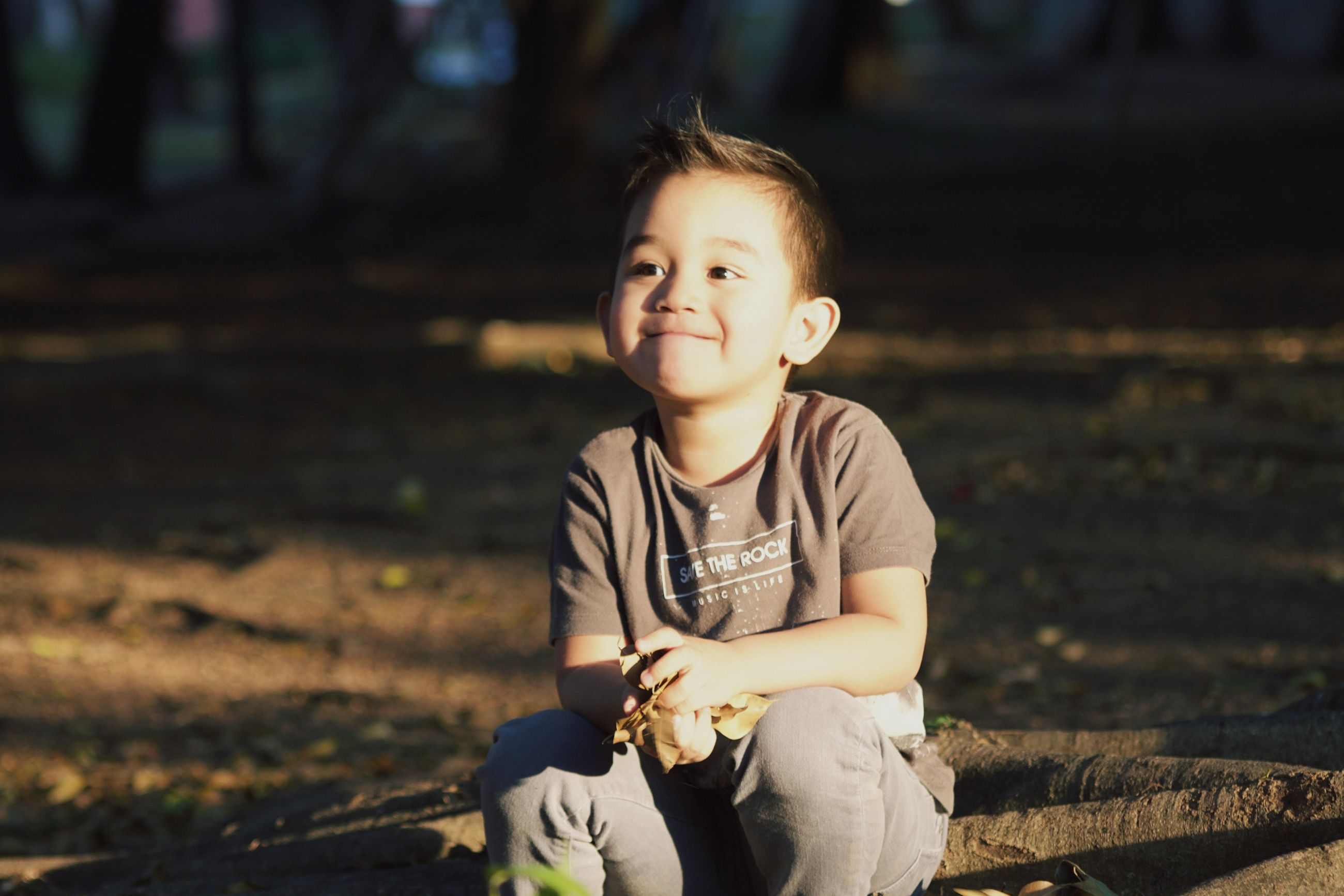 one person, childhood, sitting, portrait, baby, people, outdoors, babies only, real people, babyhood, smiling, close-up, day
