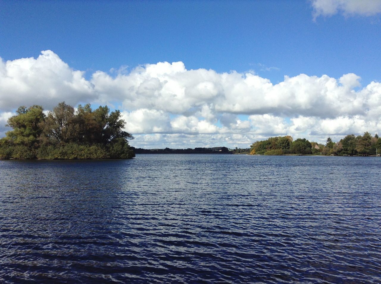 Lake near Plön. · Germany Schleswig-Holstein Norddeutschland Water Waterfront Rippled Nature Landscape Island Trees Green Blue Sky Outdoors No People
