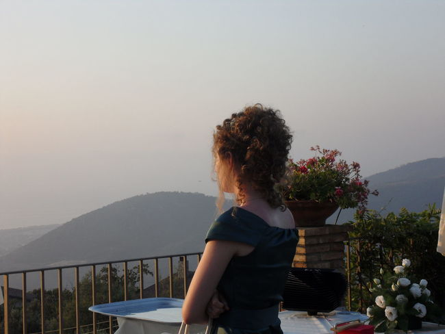 Ovee the sunset and far away Backside Portrait Looking At View Lost In Thought... People Watching Sunset Take A Look At The World Differently Towards Sunset Tranquil Scene Young Woman Woman Portrait Looking Into The Future On A Terrace
