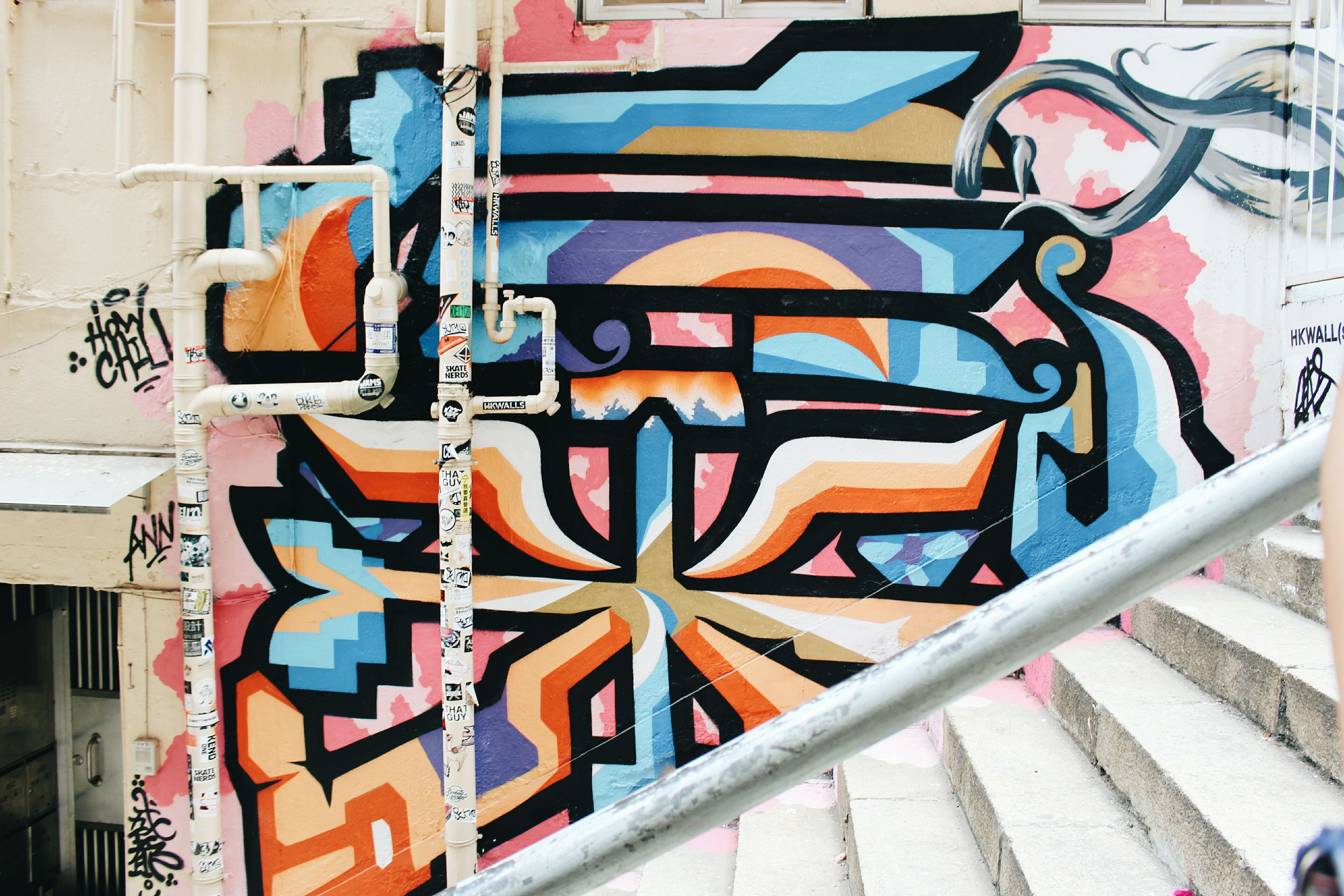 architecture, built structure, building exterior, wall - building feature, graffiti, art, art and craft, creativity, pattern, building, design, window, wall, day, railing, brick wall, no people, outdoors, multi colored, low angle view