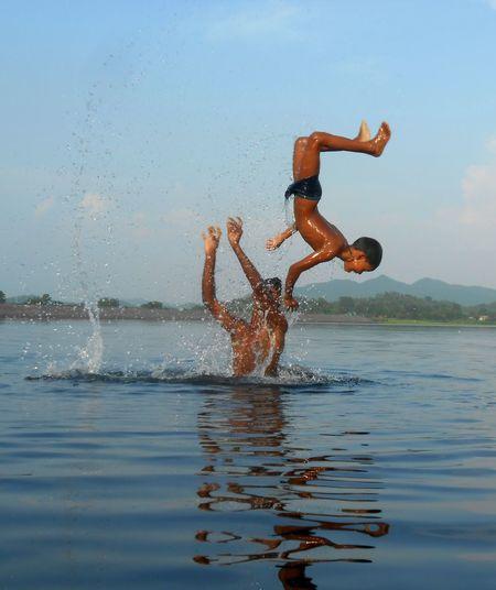Eyem Best Shots Fun Joyful Jumping Nature People Real Fun Real People Riverside Splashing Stunt Water The Great Outdoors - 2017 EyeEm Awards