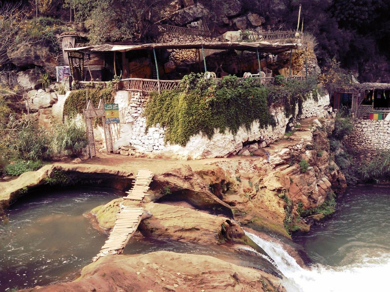 river, bridge - man made structure, water, connection, tree, rock - object, architecture, nature, no people, bridge, outdoors, built structure, waterfall, forest, scenics, day, footbridge, beauty in nature