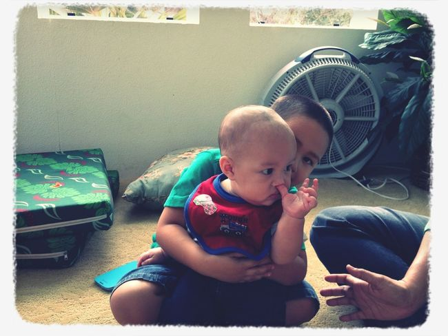 Little brother holding baby cousin Jayden.
