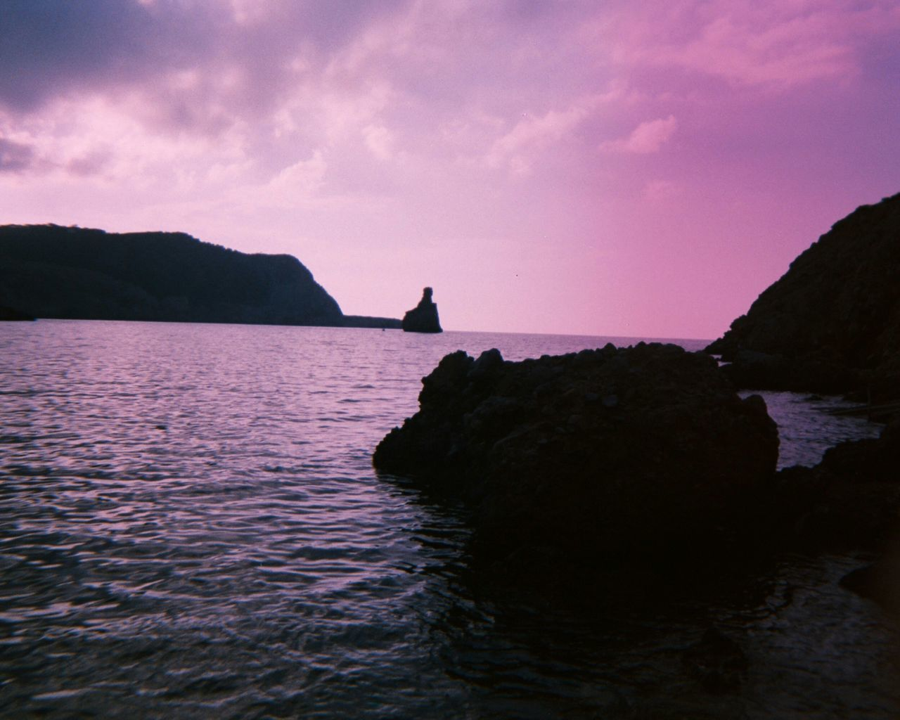 Ibiza Sunset Beauty In Nature No People Sunset_collection Rock Formation Sea And Sky Imperfectly Perfect Analogue Photography Unedited Film Photography Nature_collection Light And Shadow Ibiza Water_collection Silhouette_collection Purple Hue Travel Destinations Disposablecamera Seaside Ibiza Beach Finding New Frontiers Millennial Pink The Secret Spaces