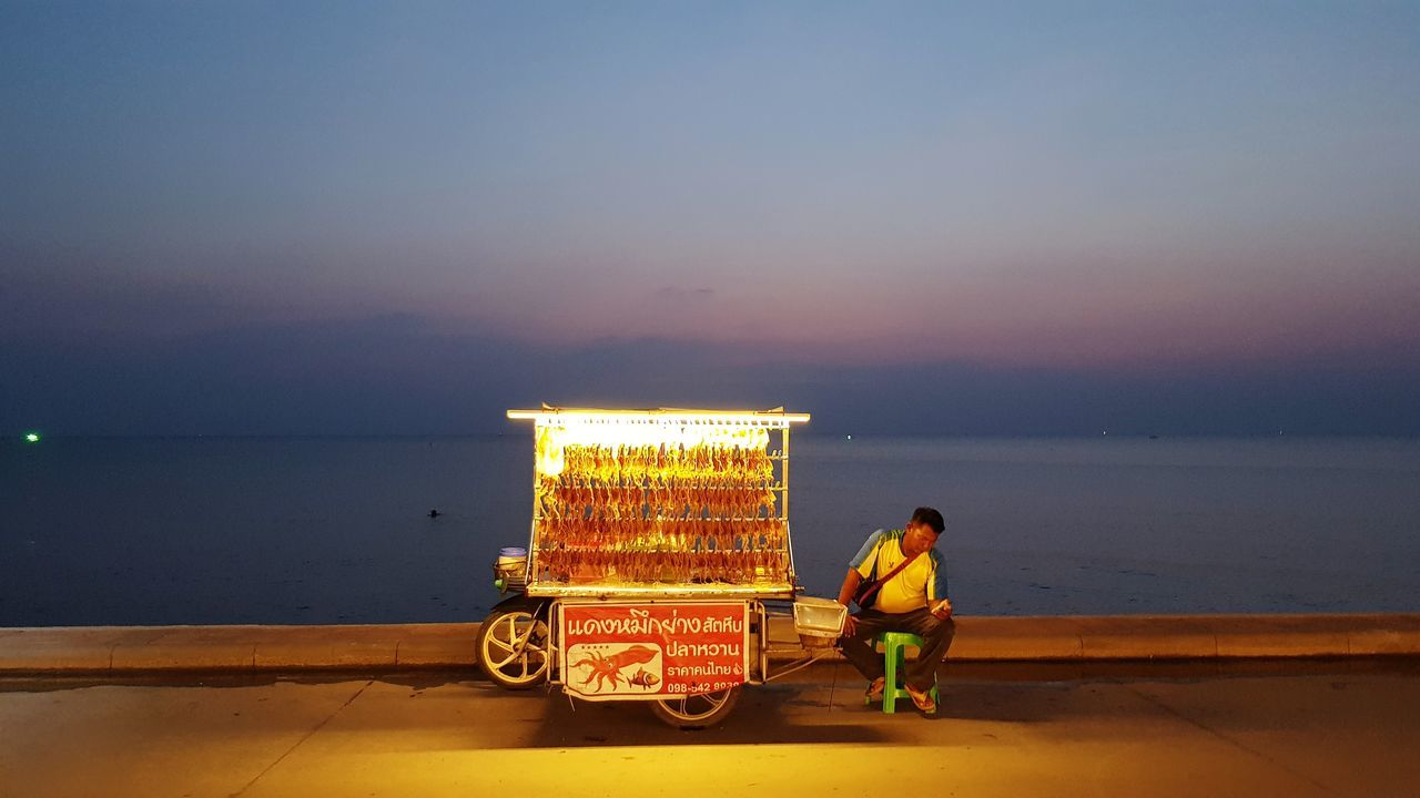 Squid Dried Squid Rows Of Things Twilight Twilight Sky Beach Sea Vendor Street Photography Mobile Photography Snack Food Waiting For Customers Jomthien Pattaya Sky And Sea Adult