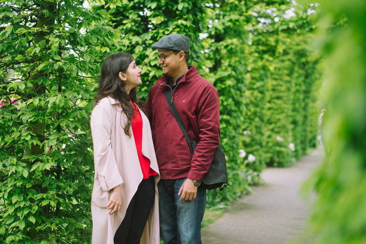 Couple amidst nature while travelling together Adult Adults Only Affectionate Bonding Casual Clothing Couple - Relationship Friendship Green Happiness Heterosexual Couple Love Men Nature Nature Outdoors People Real People Romance Standing Togetherness Travel Tree Two People Young Couple Young Women