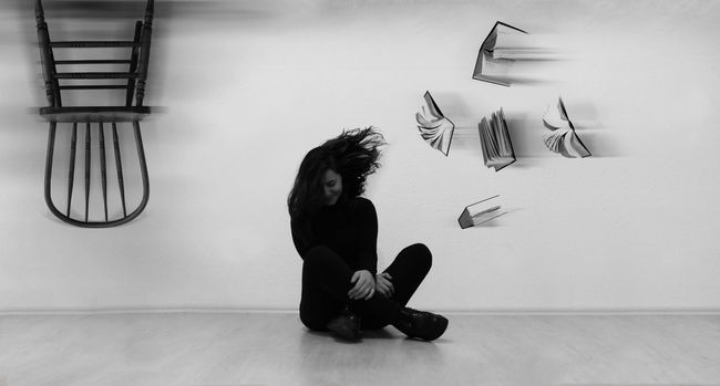 This photo shows a person smiling while she's getting books and refusing a chair which is upside down, shows her need for knowledge instead of power of being on a high seat, because knowledge is the only pure power that exists. Black And White Books Chair Conceptual Conceptual Photography  Girl Government Knowledge Person Power Surrealism