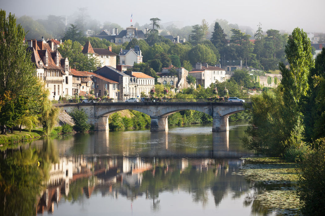 Picturesque view of Perigueux town in France Architecture Bridge - Man Made Structure Building Building Exterior Built Structure Cityscape Day Dordogne Fog France Haze Nature No People Outdoors Perigord Picturesque Périgueux Reflection River Sky Tree Vezere View Water Waterfront
