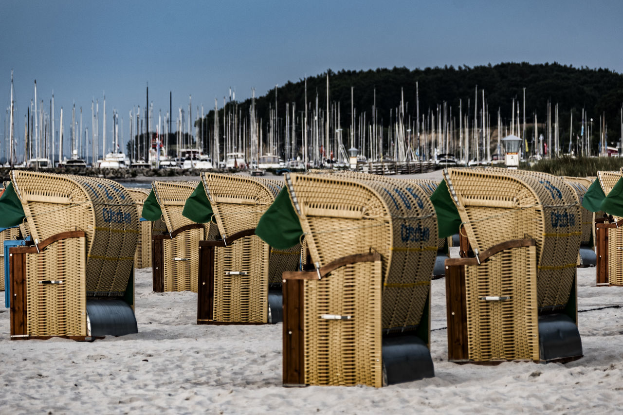 beach chairs Baltic Sea Arrangement Basket Beach Beach Chairs Beauty In Nature Chair Day Hooded Beach Chair In A Row Large Group Of Objects Nature No People Outdoors Sand Scenics Sea Shore Sky Tranquil Scene Tranquility Water Whicker Yachthafen Grömitz