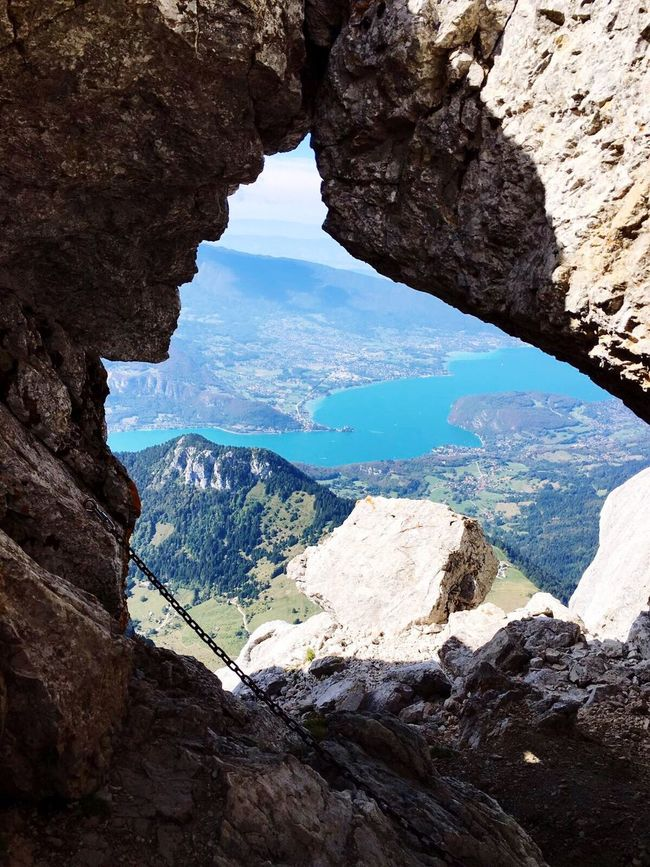 Rock - Object Geology Rock Formation Nature Beauty In Nature Scenics Physical Geography Sky Tranquility No People Natural Arch Outdoors Hiking Lake View Atthetop Rock Window View From Above Landscape_photography France French Alps Authentic Moments Mountain Range Landscape_Collection