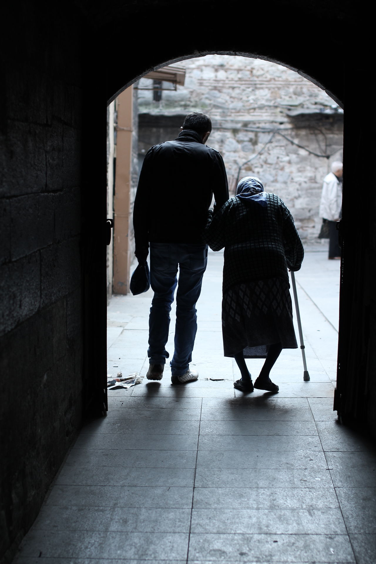 Full Length Melancholic Silhouette Rear View Togetherness Family Elderly Woman Love Caring For The Elderly Old Age Helping Hand Affection Tenderness Respect The Elders Capture The Moment