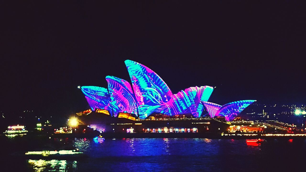 Arts Culture And Entertainment Night Illuminated City Architecture Travel Destinations Outdoors Business Finance And Industry Cityscape Sky Skyscraper Urban Skyline Building Exterior No People Sea Water Popular Music Concert Vivid Opra House