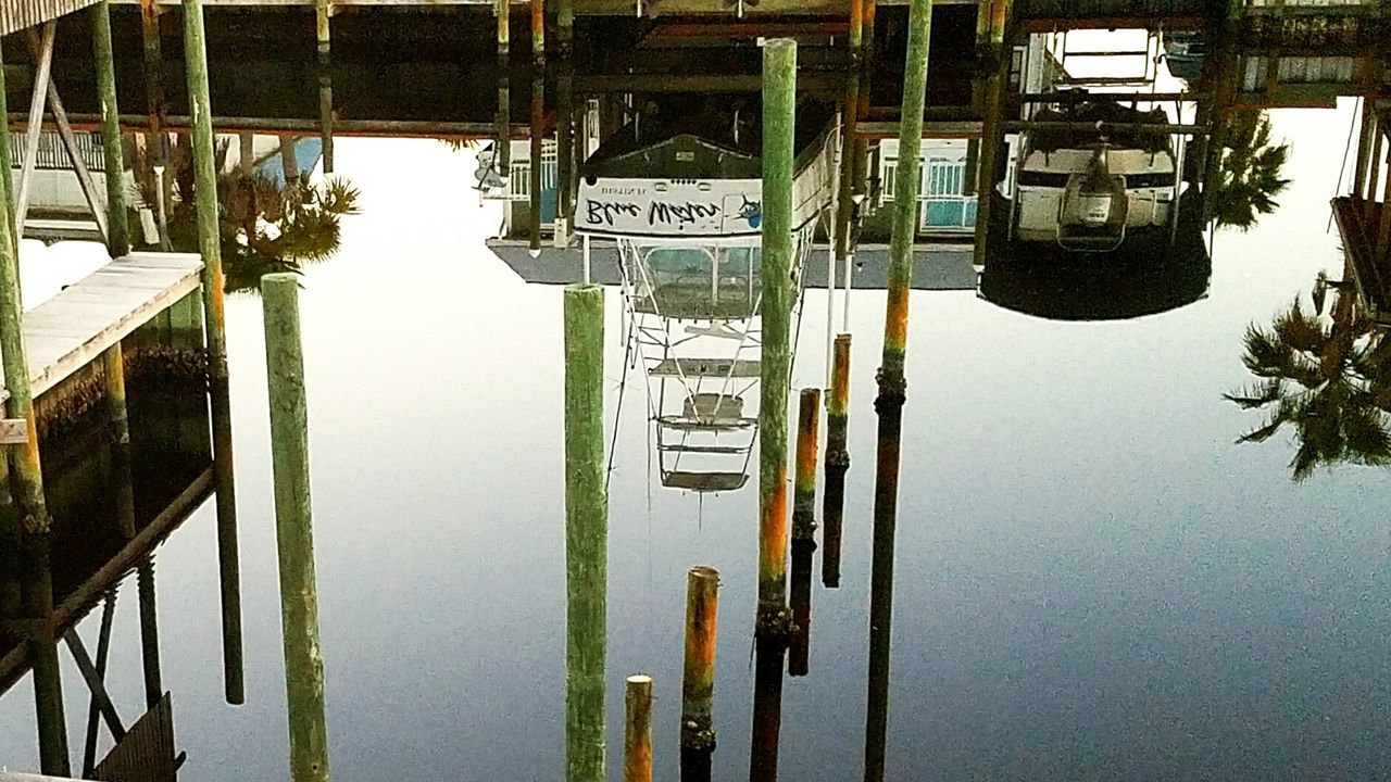 Water No People Day Outdoors Nature Sky Reflection Samsung Galaxy S7 Eyeemphotography Simplicity.  Reflection In The Water Reflection Photography Reflection Perfection  Boats And Water Dock Side Docks Dockside Pilons Pier Photos Pier Canal Upside Down Optical Illusions