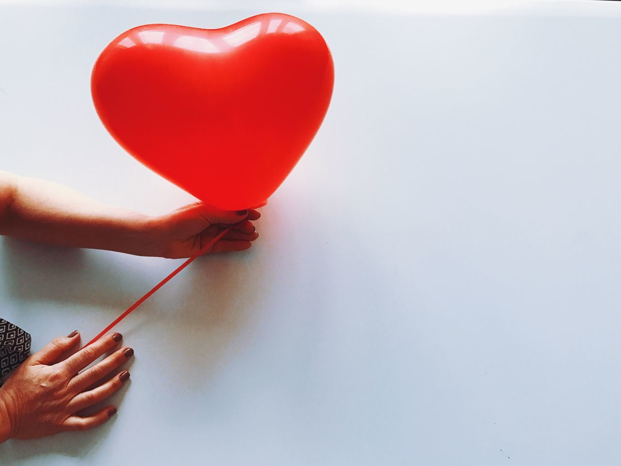 Heart Shape Red Love Human Hand One Person Human Body Part Holding Balloon Real People Close-up Indoors  Day