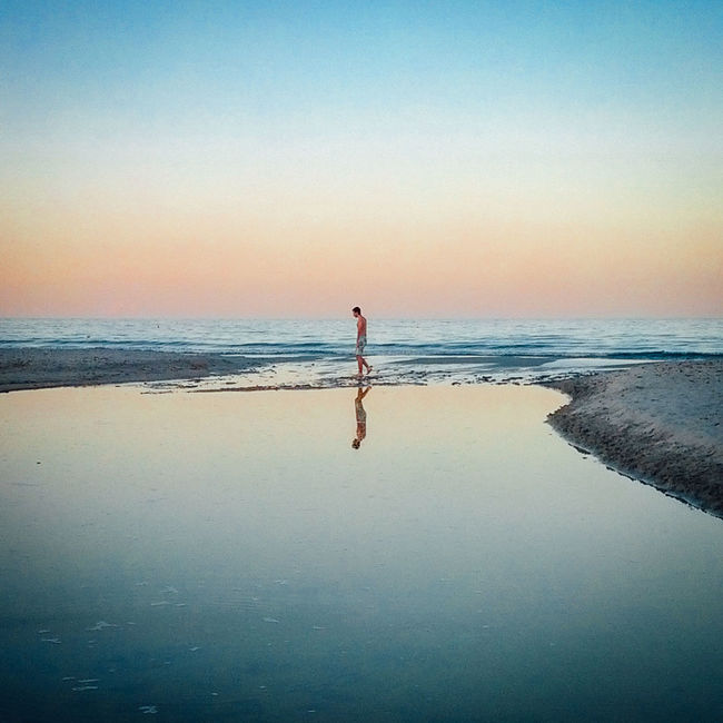 Lonely Beach Boy Italia Italy Lonely Man Mare Nature Nightfall Reflection Reflections Sardegna Sardinia Sea Seascapes Siniscola  Sunset Tranquility People Of The Oceans