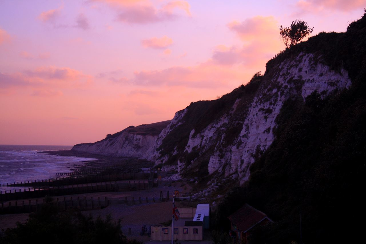 Sky Beauty In Nature Mountain Nature Sunset Scenics Cliff Tranquility Outdoors No People Water Sea Cloud - Sky Architecture Day Beachy Head Eastbourne