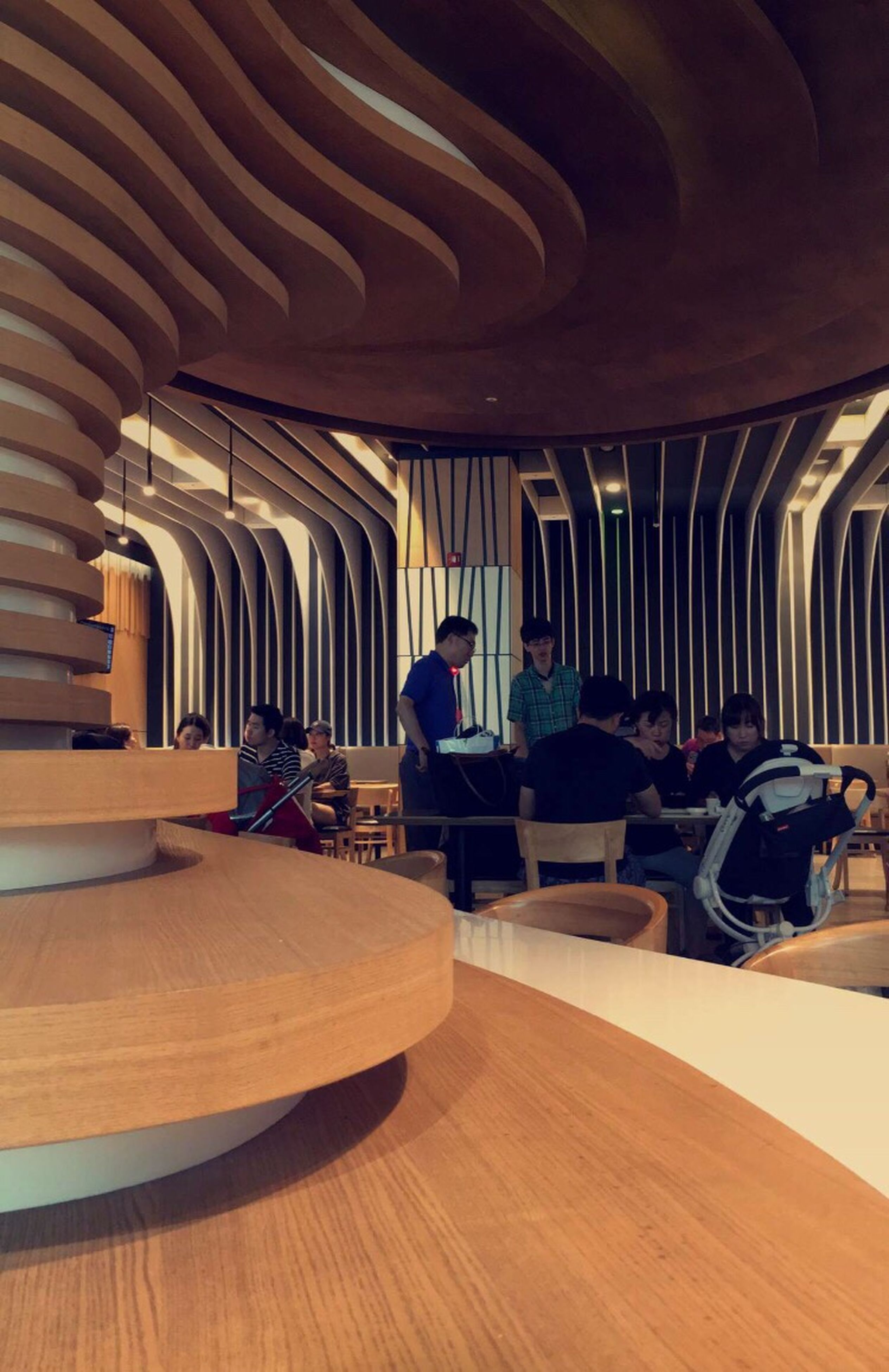 indoors, arch, table, wood - material, architecture, chair, built structure, sitting, seat, illuminated, real people, day
