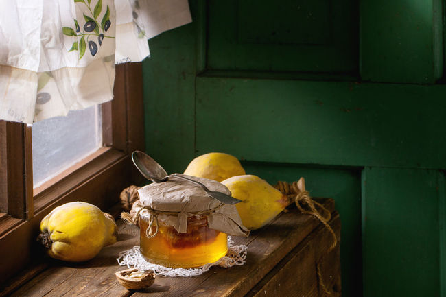 Three whole juicy quinces with whole and split walnuts over natural brown stone surface in sunlight. Day Lights Rural Rustic Sunny Day Food Food And Drink Freshness Fruit Healthy Eating Honey Indoors  Kitchen No People Quince Quinces Table Window Windowsill Wooden Yellow Fresh On Market 2017