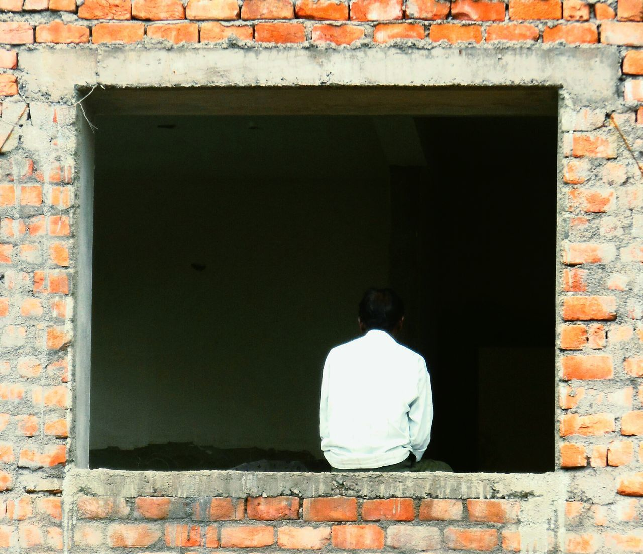 AnaGraph™ One Person Day Nikonphotography India Bricks Red Framed Outdoors One Man Only Frame It! Building Thoughts Thoughtful Deep Deep Thought Nikon Missing Cent