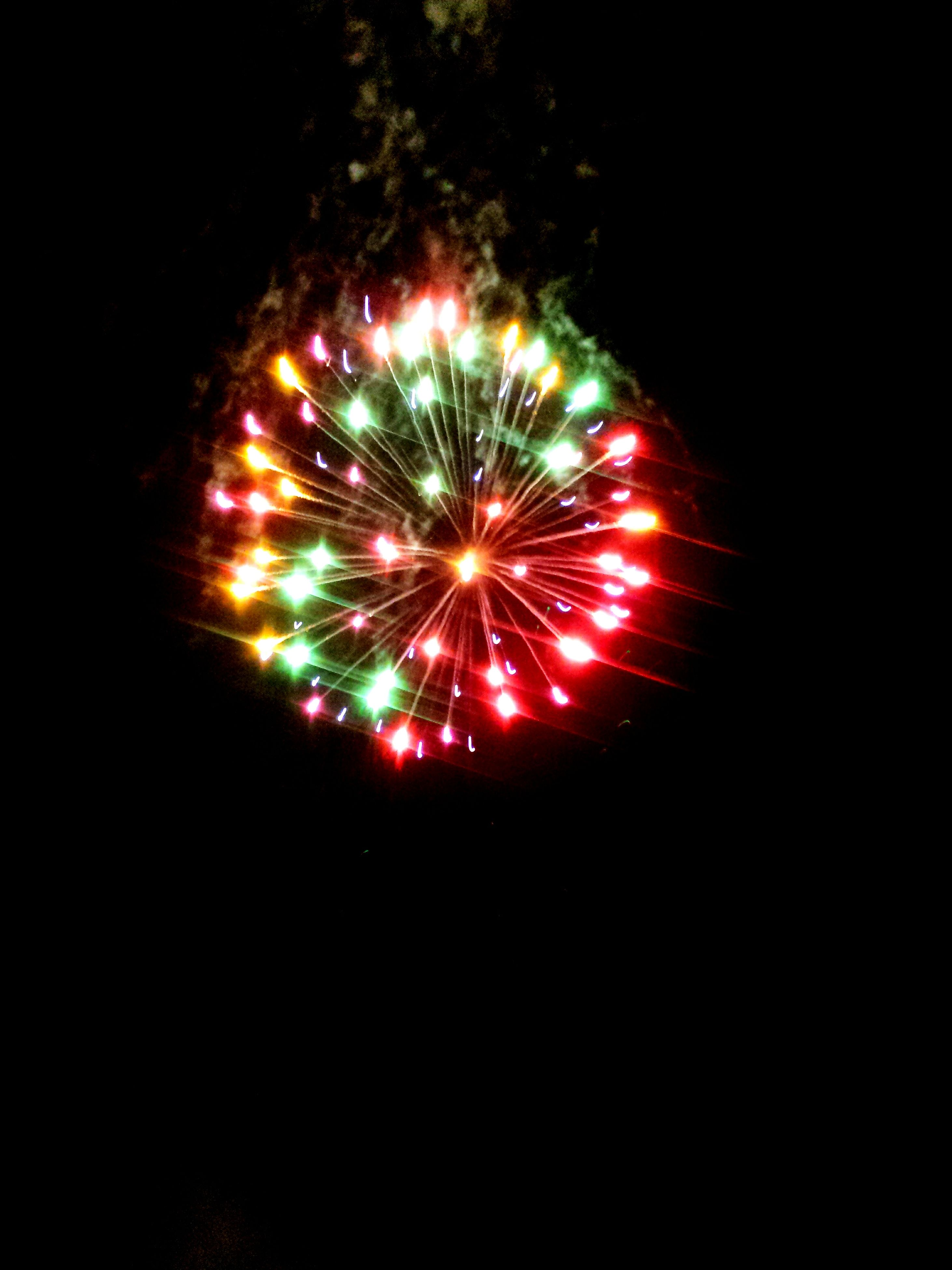 night, illuminated, celebration, firework display, glowing, exploding, long exposure, multi colored, firework - man made object, red, event, motion, arts culture and entertainment, sparks, celebration event, firework, low angle view, fire - natural phenomenon, entertainment, blurred motion