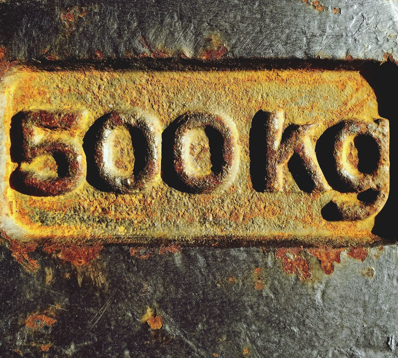 No People Communication Close-up Text Day Outdoors KG Industry Five Zero Old Number Numbers Weight Five Hundred Metal Work Hundredth Industrial Equipment Weights Metal Art Old Metal Red Rost Heavy