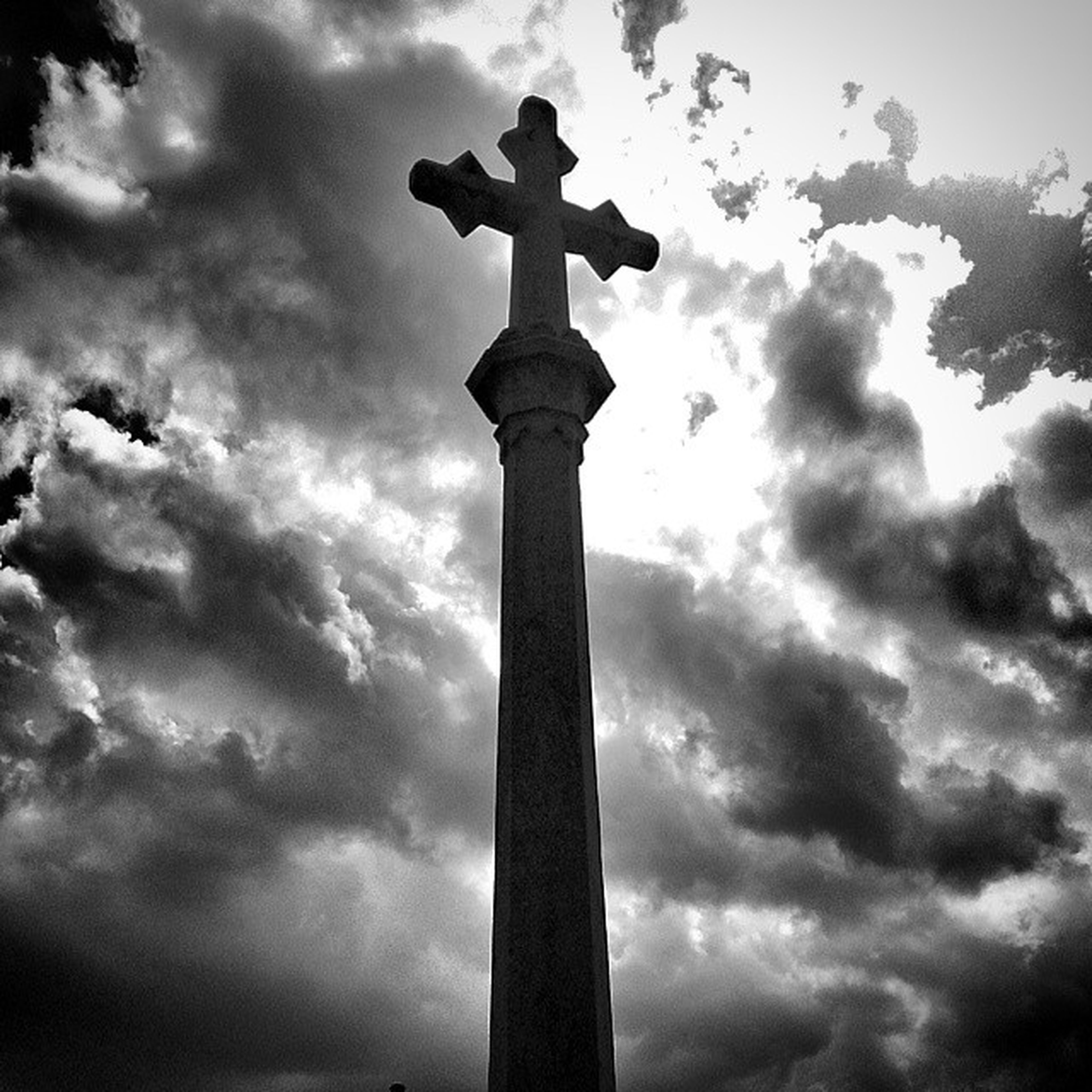 sky, low angle view, cloud - sky, cloudy, silhouette, cloud, weather, cross, dusk, overcast, no people, nature, outdoors, sculpture, tranquility, statue, religion, built structure, spirituality, architectural column