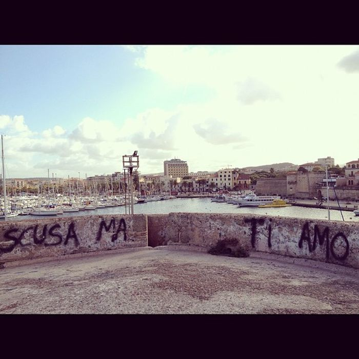 """More writings on the tower of Saint Erasmus in #alghero #sardinia. Now this is possibly even worse than writing """"I hate everyone / kill everyone"""" on the wall under such a gorgeous view: """"scusa ma ti amo"""" (""""sorry but I love you""""), apparently a quote from s Alghero Sardinia Cringe"""