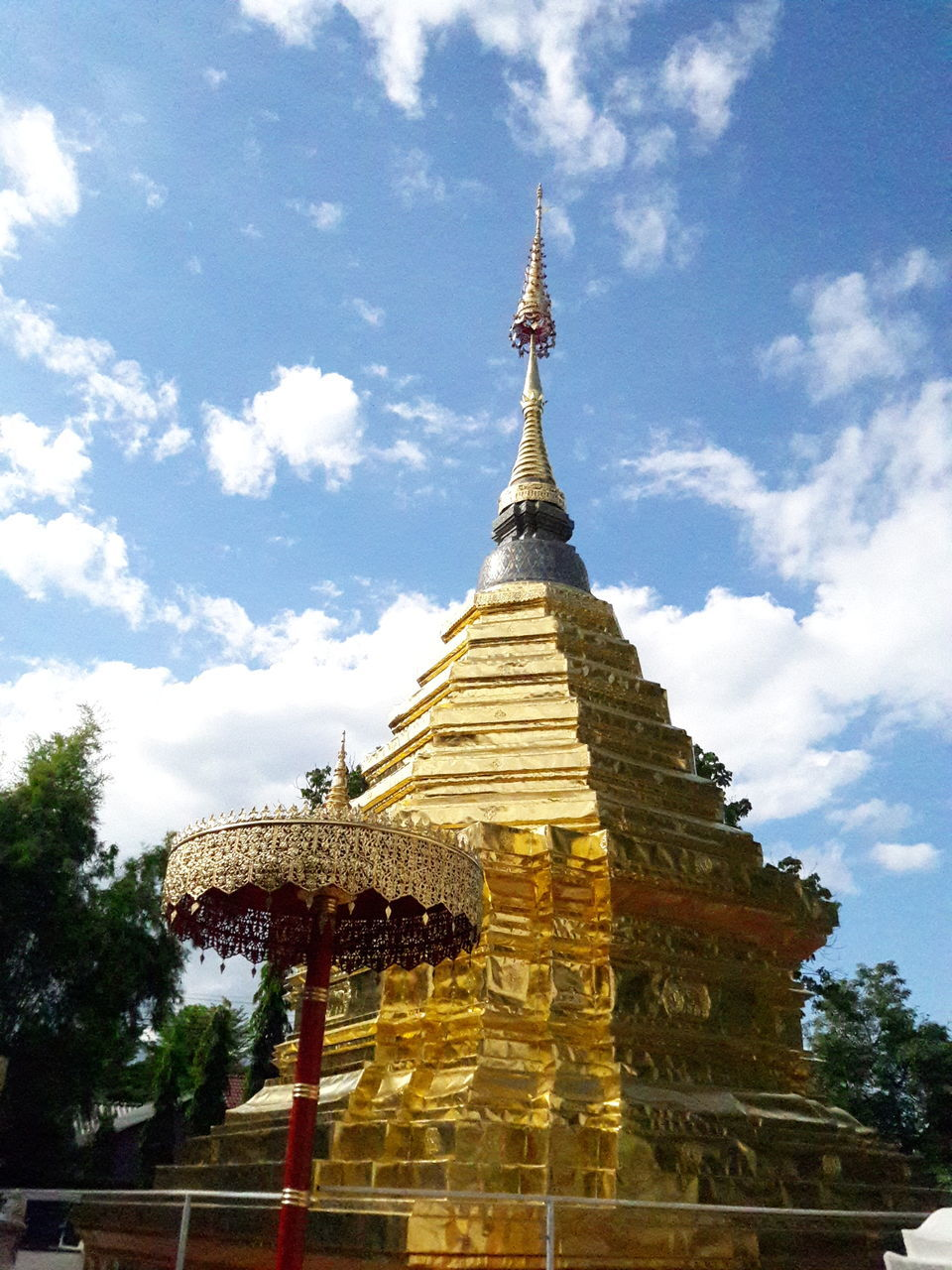 religion, spirituality, architecture, pagoda, sky, place of worship, built structure, no people, history, building exterior, cloud - sky, ancient, gold colored, day, travel destinations, tree, statue, outdoors, nature