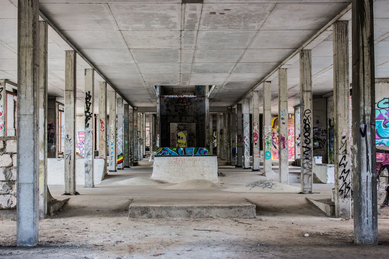 Abandoned Architecture Day Distroyed Emptiness Empty Graffiti Lost Places No People Outdoors Retail  Perspective Photography Perspective Perspective View Columns Columns And Pillars Pylons Backbone Concrete Concrete Pillars Concrete Wall Concrete Floor Skatepark