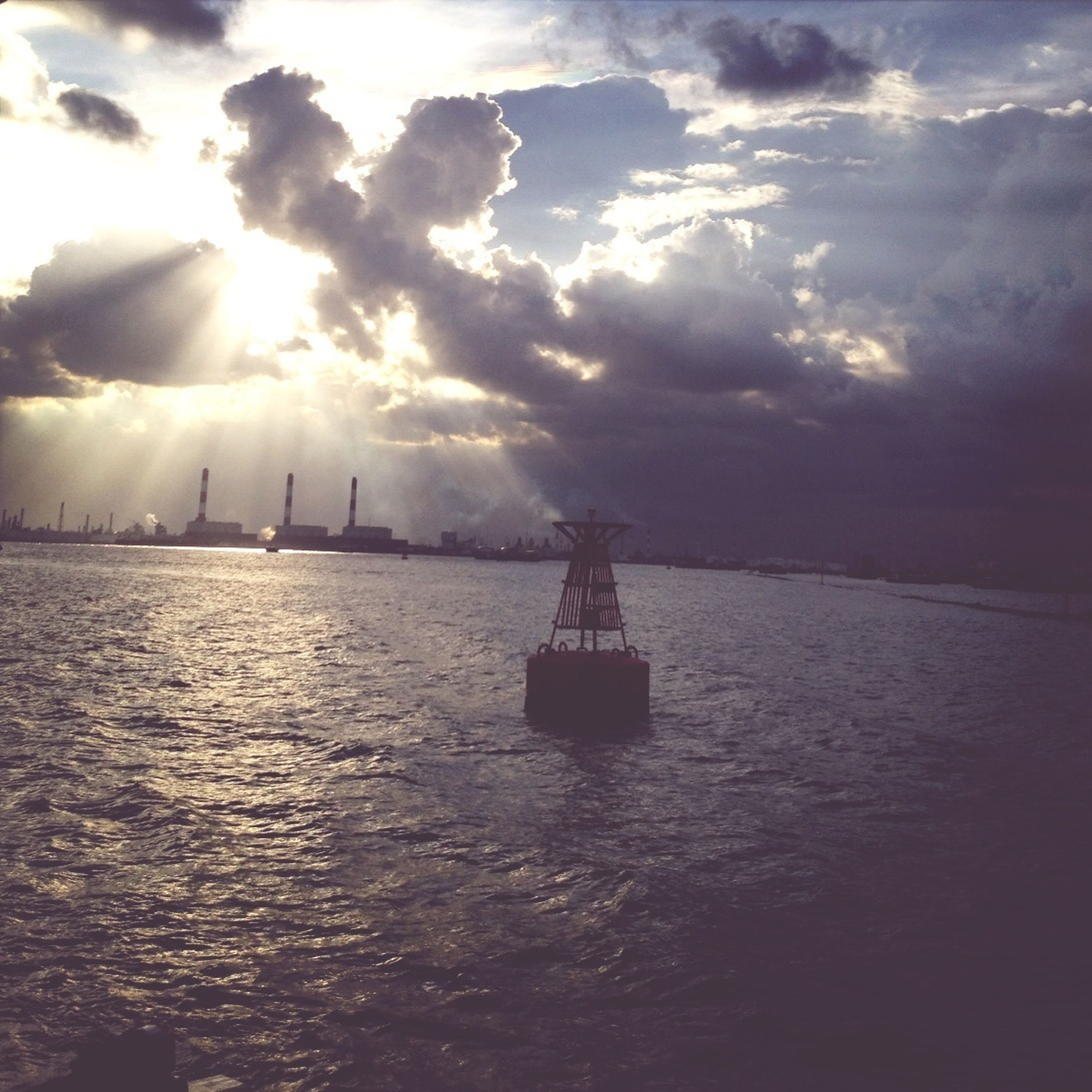 water, sky, sea, nautical vessel, waterfront, cloud - sky, transportation, mode of transport, boat, scenics, cloudy, tranquility, tranquil scene, sunbeam, beauty in nature, sun, nature, cloud, sunset, sailing