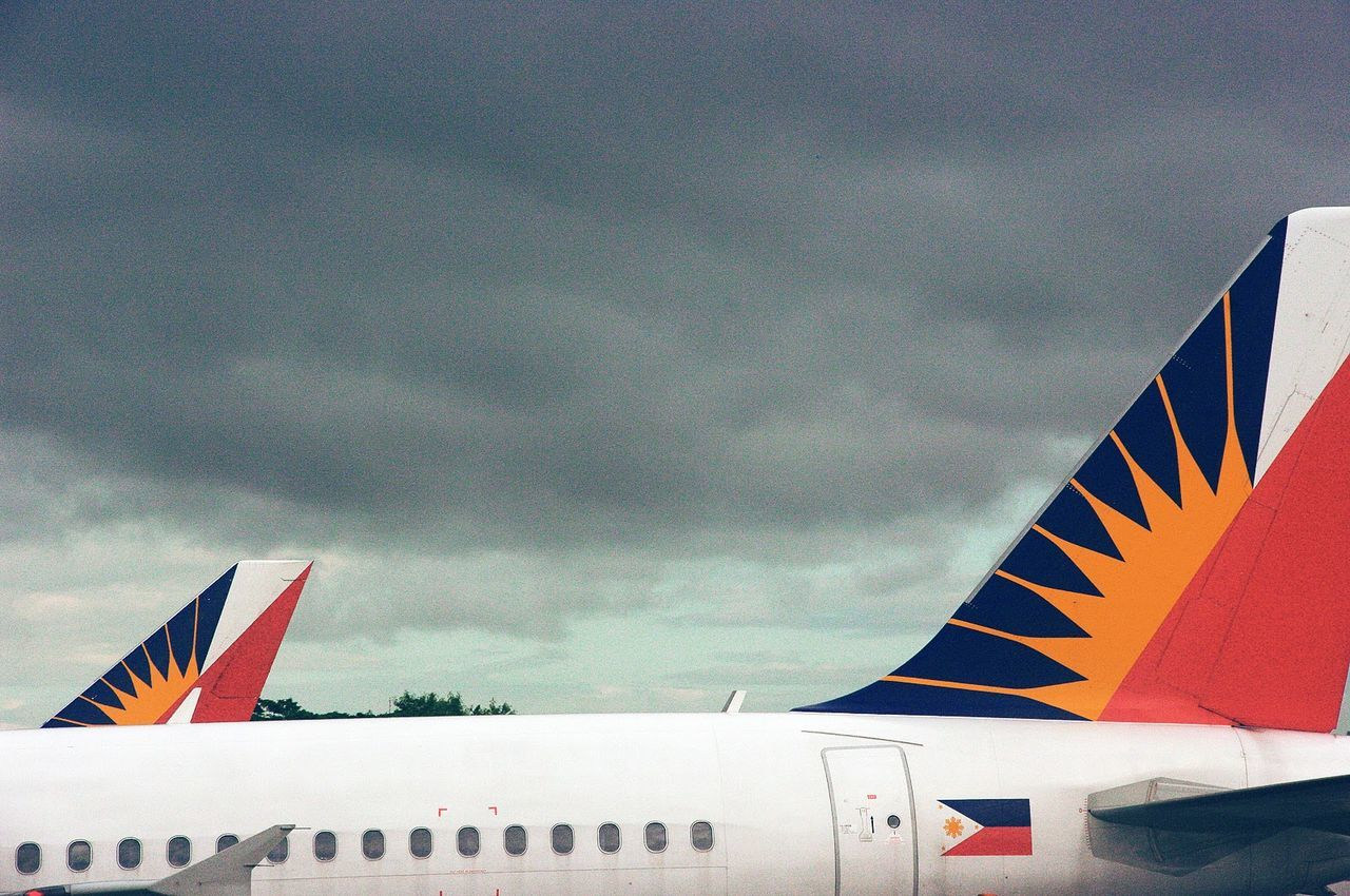 Ninoy Aquino International Airport, Manila, 2009 Atmospheric Mood Cloud Cloud - Sky Cloudy Day Flag High Section Identity Low Angle View Multi Colored National Flag No People Outdoors Red Sky Storm Cloud Manila Airport Manila Manila Phillipines Departing Philippines Airlines Aircraft Cloudy Day Cloudy Sky Traveling