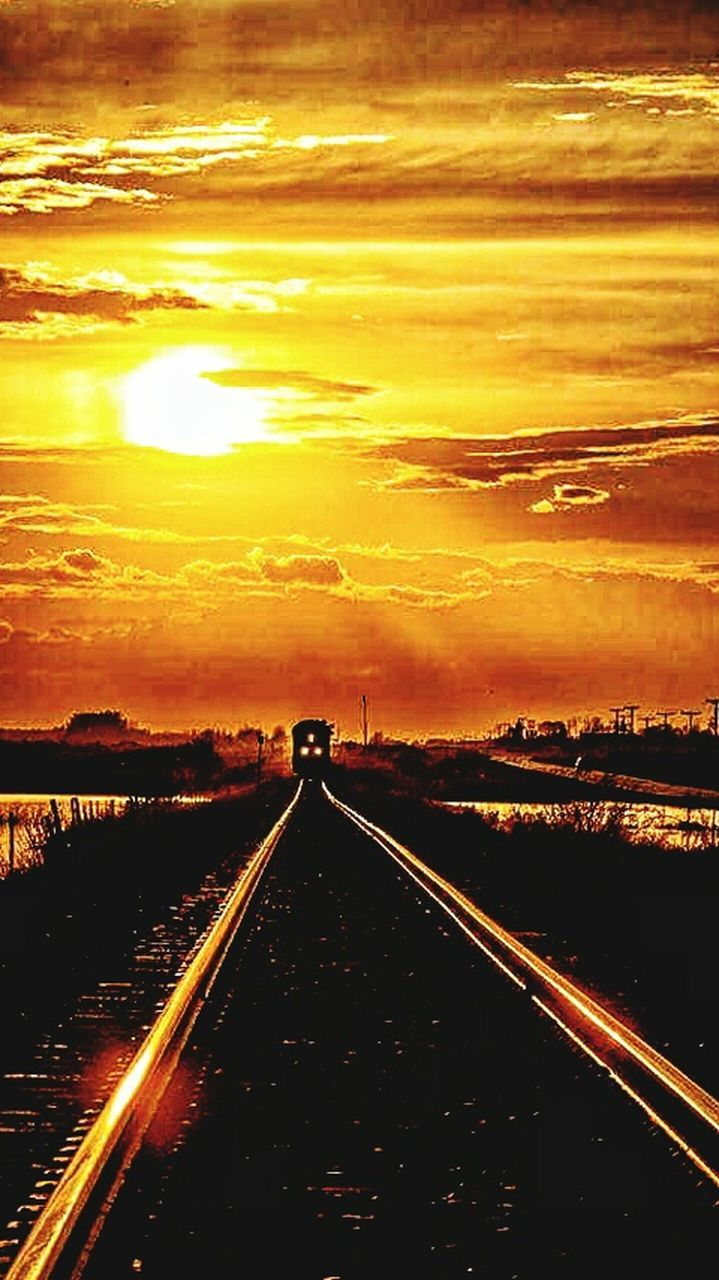 sunset, the way forward, no people, outdoors, sky, sunlight, transportation, railroad track, scenics, nature, beauty in nature, road, day