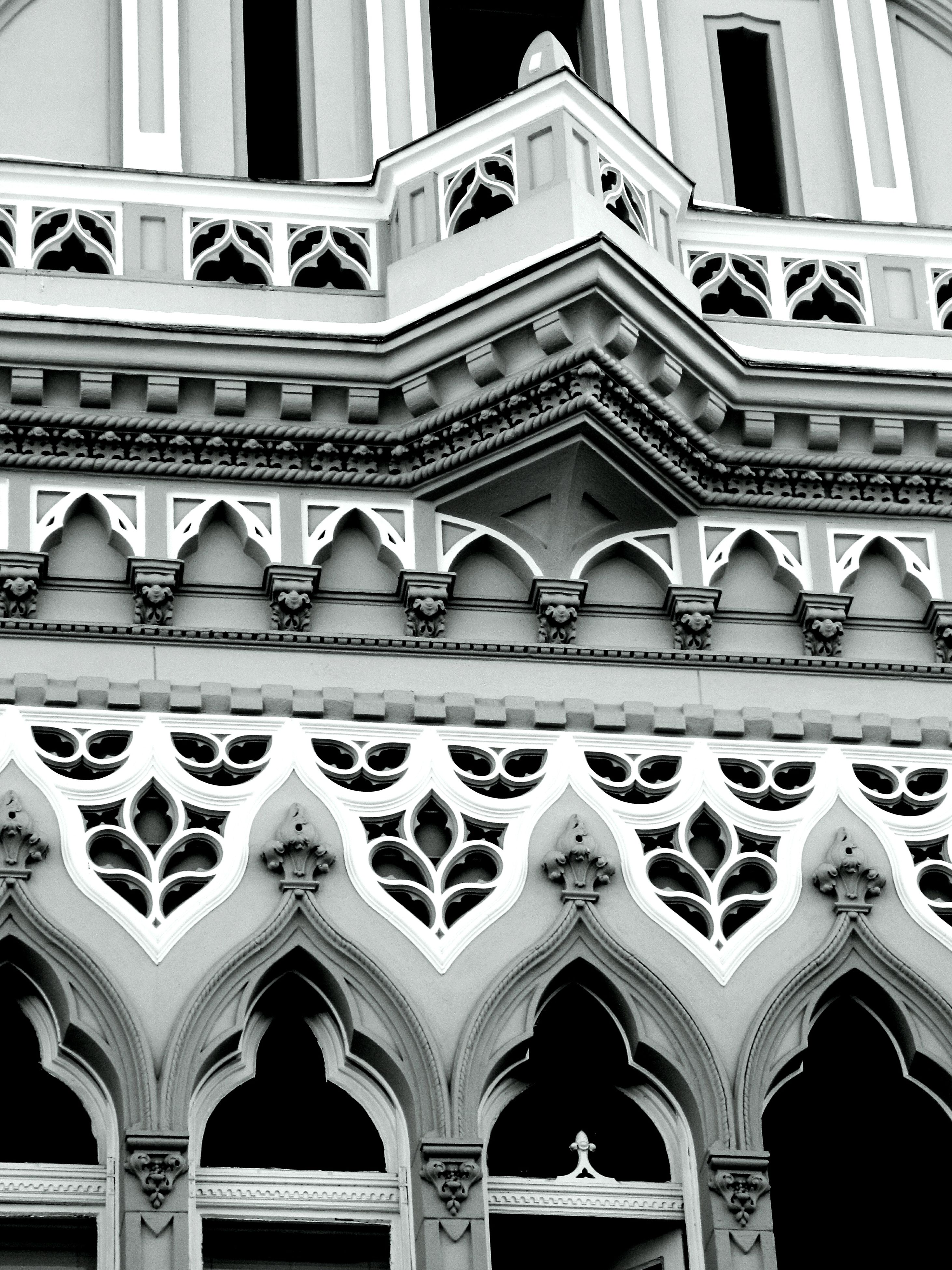 architecture, built structure, building exterior, low angle view, arch, window, ornate, design, pattern, repetition, architectural feature, history, facade, building, no people, in a row, day, full frame, famous place, travel destinations